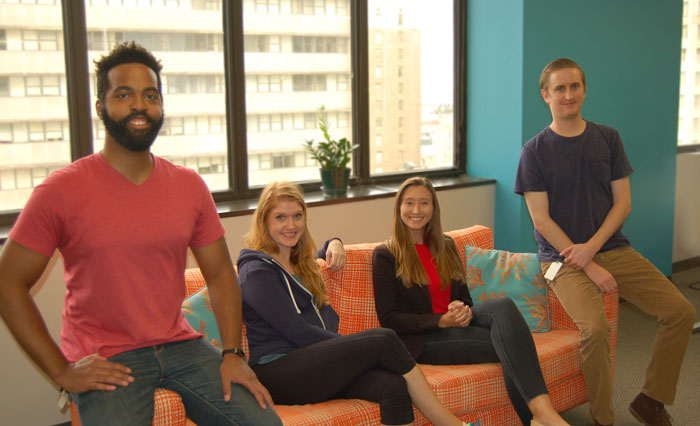 Employees at Search Influence sitting on a couch