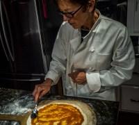Jo Ann layering the sauce