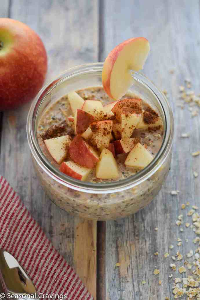 Apple Pie Overnight Oats in a jar with an apple slice on the side
