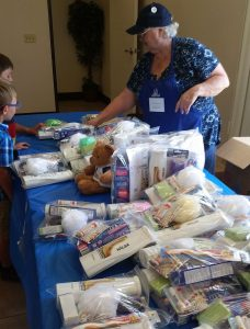 Assistance League volunteers give free hygiene supplies to military kids.