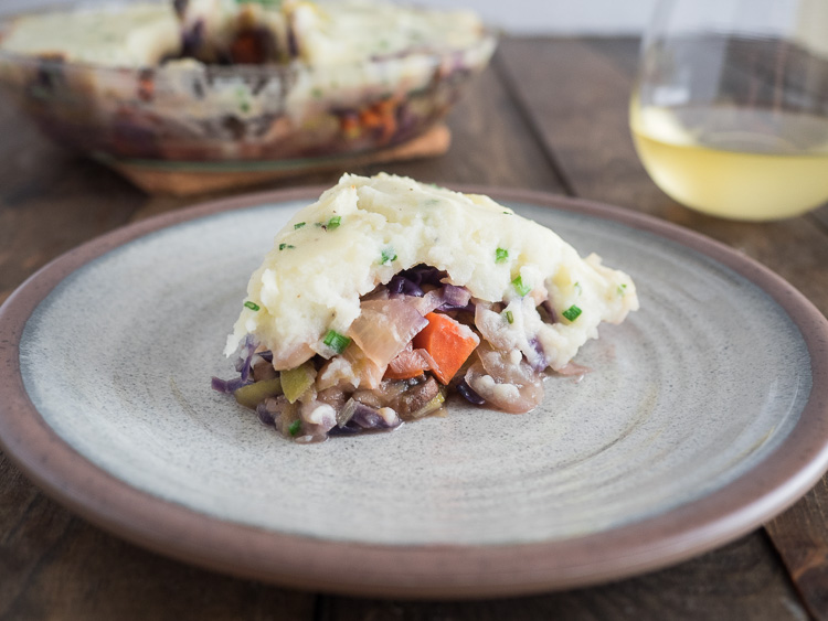 Vegetarian Shepherd's Pie | A vegetable forward twist on classic shepherd's pie, this vegetarian version features leeks and white beans with cabbage and carrots. All topped with garlic and chive mashed potatoes. | seasonedvegetable.com