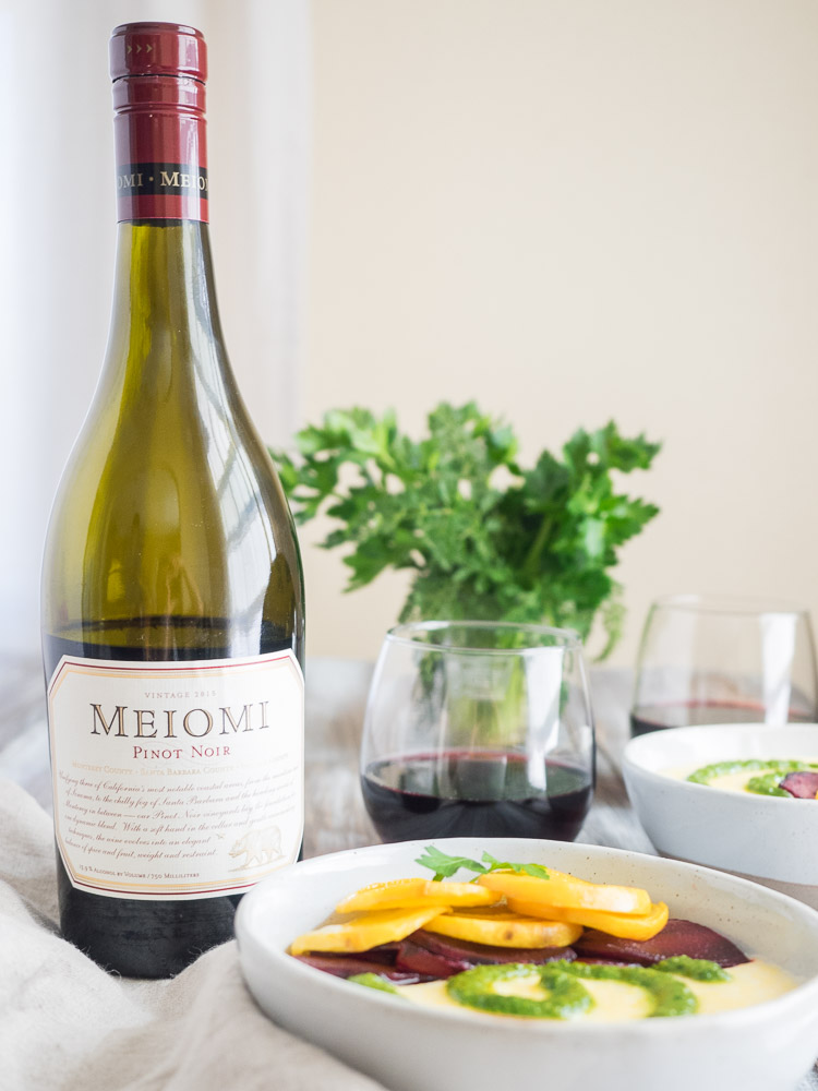 Goat Cheese Polenta with Meiomi Pinot Noir | This warm, creamy, goat cheese polenta with roasted beets and bright arugula pesto is a delicious dish for a dinner party or date night at home. | SeasonedVegetable.com