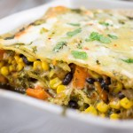 Sweet Potato Enchilada Casserole | An easy enchilada casserole that is hearty and ready to feed a crowd. Filled with sweet potatoes, black beans, and corn, topped with a homemade chimichurri sauce. | SeasonedVegetable.com #sweetpotato #casserole #vegetarian
