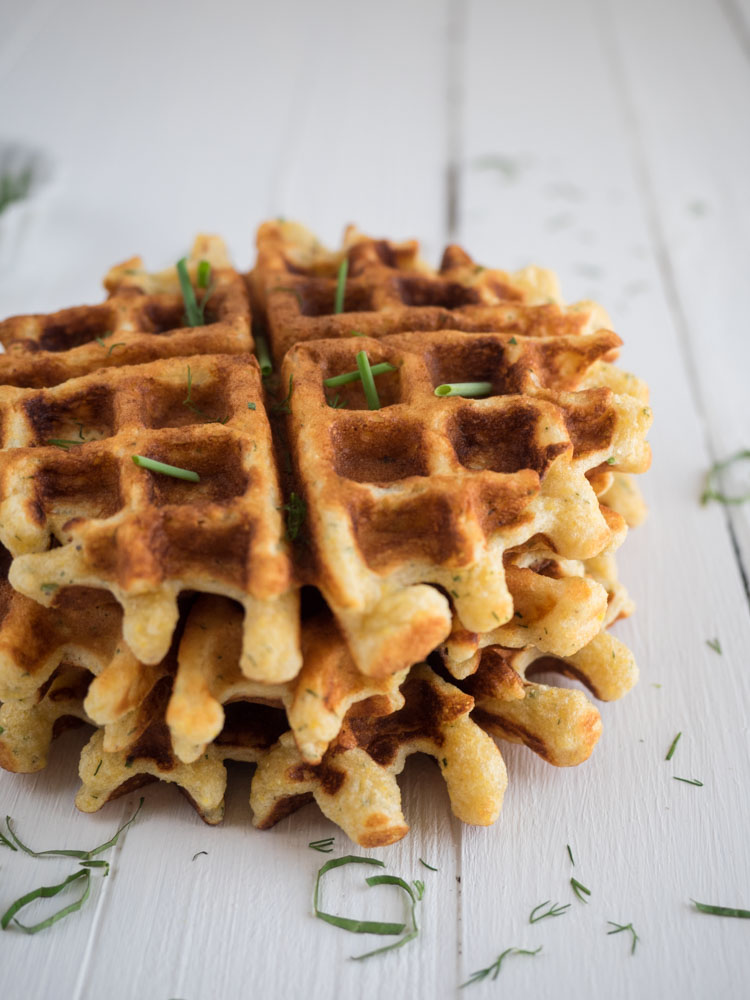 Savory Cornmeal Waffle | An easy roasted vegetable ratatouille uses the bounty of summer produce. Seasoned with fresh basil and served atop crispy, herby cornmeal waffles. | SeasonedVegetable.com