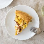 Curried Vegetable Galette | A hearty vegetable galette with curry roasted winter vegetables paired perfectly with a light, crisp, off-dry Symphony white wine. | SeasonedVegetable.com #fallrecipes #curriedvegetables