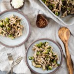 Baked Brussels Sprouts Pasta with Walnut Sauce | This brussels sprouts pasta is prepared with a creamy walnut sauce then baked and topped with caramelized onions for a hearty, delicious fall meal. | SeasonedVegetable.com #veganpasta #falldinner #roastedbrusselssprouts #thanksgivingrecipe #vegetarianbrusselssprouts