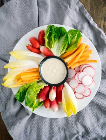 Caesar Salad Crudite | A caesar salad crudite platter makes it easy to have caesar salad as an appetizer. With fresh cut vegetables, it's a fun finger food for a crowd! | SeasonedVegetable.com #partyplatter #vegetableplatter #caesarsaladappetizer