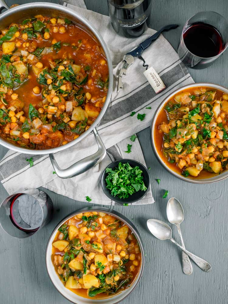 Chickpea Chard and Potato Stew | This one pot potato stew with chickpeas and chard is an easy, gluten free and vegan meal. Hearty, delicious, ready in 30 minutes. | SeasonedVegetable.com #veganrecipe #glutenfreerecipe #soup #dinner #vegetarian #winepairing