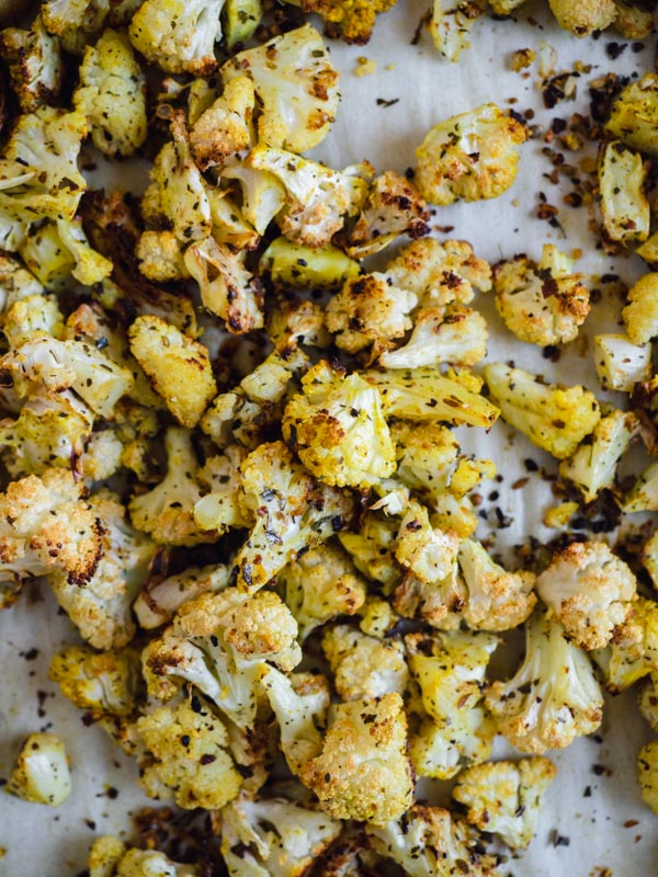 Curry powder roasted cauliflower on a baking sheet right out of the oven.
