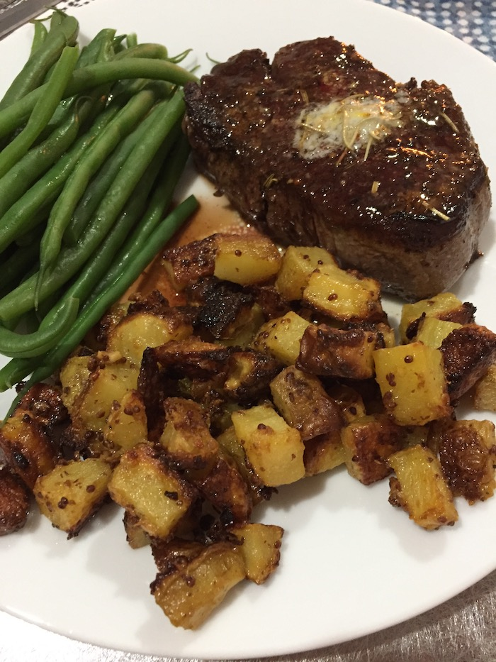 Mustard-Crusted Potatoes with steak (A Seat at the Table)