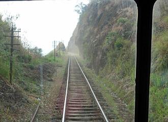The railway hugs the hillside