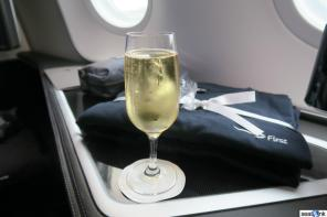 PDB champagne with the first class pajamas and amenity kit