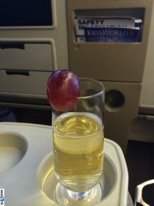 Whatever you do, do NOT drop the grape into your champagne...