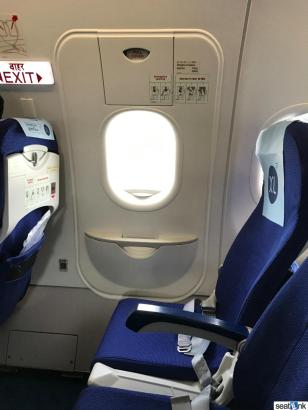 13F on IndiGo missing an armrest (as expected)