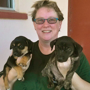 Ann with puppies that she rescued at part of a Humane Society International team on the island of Rota, Northern Mariana Islands
