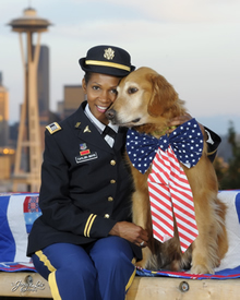 Shanda Taylor-Boyd, of Sammamish, poses with her service dog Ranger on Queen Anne Hill with the city backdrop.