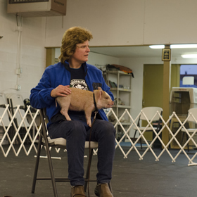 Amy and Stock watch while the instructor demonstrates an exercise during class.