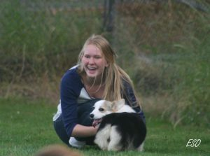 During a mentoring visit at John and Tammie Wilcox's Win-Star Bed & Biscuit in 2011, Helga Poll Gudjonsdottir, an Icelander, holds Panda, a Pembroke Welsh Corgi puppy.