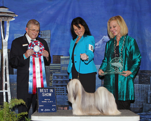 Tia McLaughlin, of Puyallup, and Madonna, a Lhasa Apso, took top honors at Sunday's all-breed show. Judge Vincent Grosso, of Banning Calif., and Seattle Kennel Club member Leslie Engen are beside the winner.