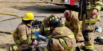 West Thurston Firefighters Save 2 Dogs Overcome by House Fire Smoke