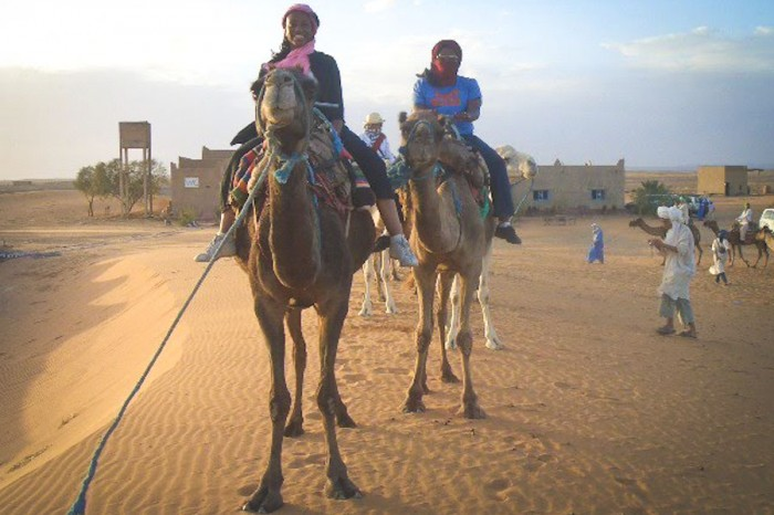 Kathy Norris (left) and the author riding camels in Morocco.