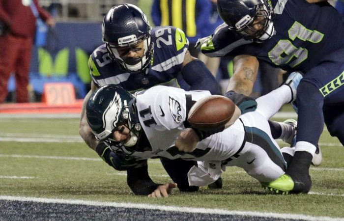 Carson Wentz fumbles the ball when trying to score in the game against Seattle (AP Photo/John Froschauer)