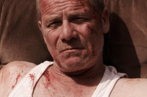 Peter Mullan, bloodied but unbowed.