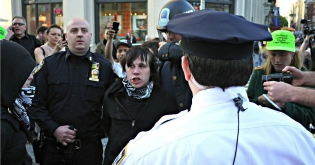 Citizen journalists cover an arrest in New York City, 2012. Photo by Timothy Karr.
