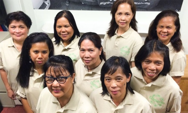 Judith Daluz (front row, right) poses with her fellows in the Damayan Cleaning Cooperative. Photo courtesy of Damayan Cleaning Cooperative.