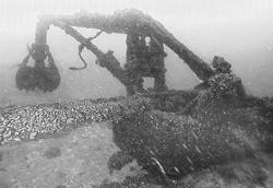 A shipwreck of a lost barge on a lake floor is shown.