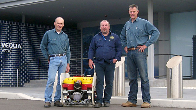 Matthew Cook, Bill Bulloch, and Geoff Cook are shown with the SeaView Systems Saab Seaeye Falcon underwater robotic remote operated vehicle (ROV) at the Sydney, Australia desalination plant.