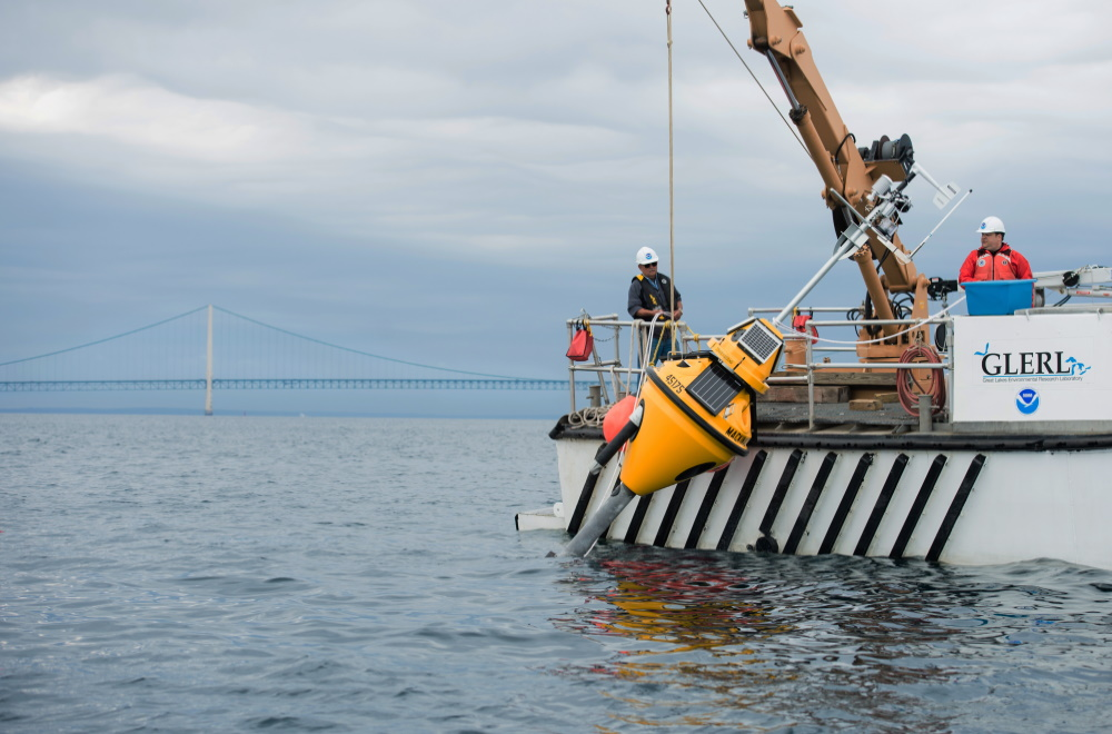A NOAA GLERL (Great Lakes Environmental Research Lab) buoy equipped with the SeaView Systems SVS-603 wave sensor is shown being deployed at the Straits of Mackinaw, Michigan.