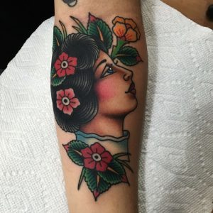 woman with flowers tattoo