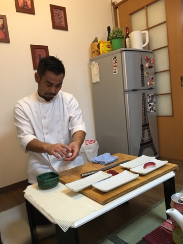 Our EatWith host, Shin, preparing sushi tableside - Japan in 3 weeks