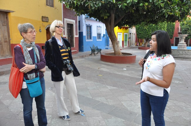 Walking tour during a local festival with one of Escuela Falcon's teachers