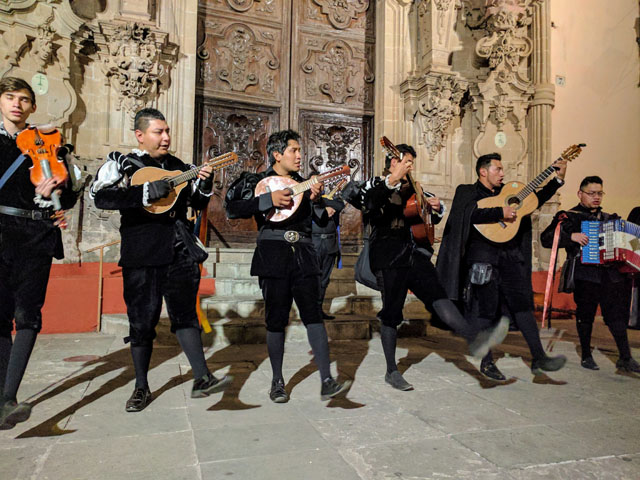 Callejoneada, a type of walking serenade, during which local musicians dress up in traditional 17th century costumes and weave their way through the cobblestone streets and narrow alleyways of colonial Guanajuato while playing music, singing popular folk songs, telling stories, and reciting local legends