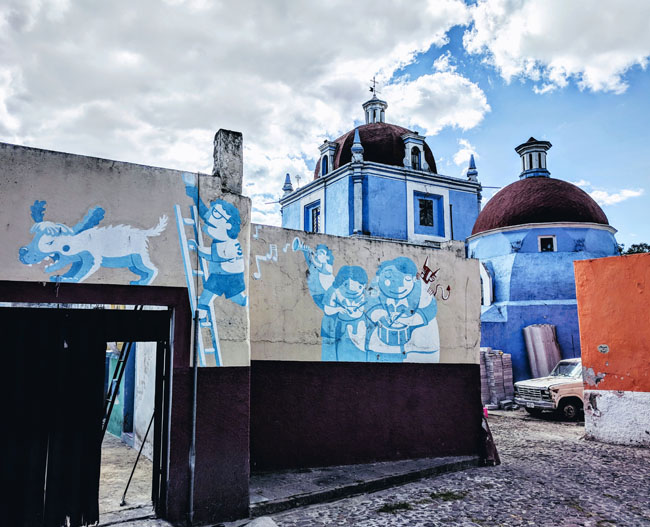 Visiting Xanenetla, a colorful neighborhood filled with incredible street art, with the guide