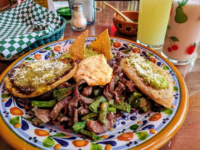 Chalupa, cheese, meat with nopales, tlayoyo, agua de guayaba, and curado de piñón (piñon-flavored pulque),Pulquería la Tía Yola, Tlaxcala City
