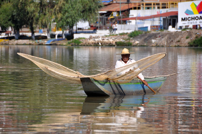 Fisherman with traditional net, Lake Pátzcuaro. I think this guy was just posing for tips.