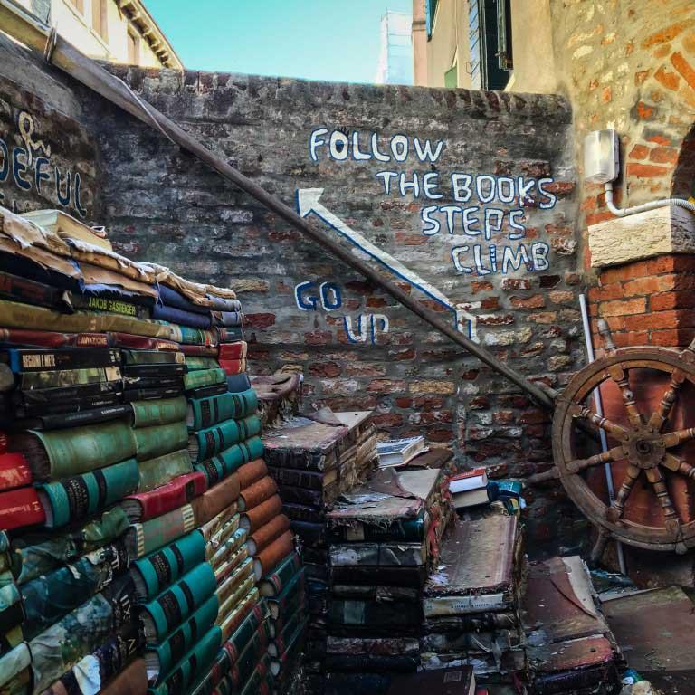 Libreria Acqua Alta staircase – Venice, Italy - best bookstores around the world