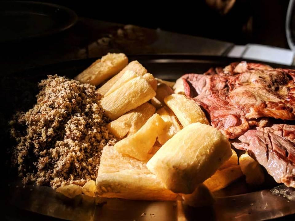Trying carne de sol, typical Northeastern Brazilian food, on a school outing to Feira de São Cristóvão