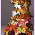 4 tiers round wedding cake with fall colors flowers in cascade from Second Slices® cakeshop bakery in Edmonton AB