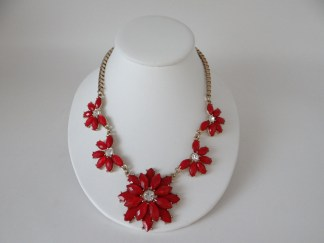 Red and clear rhinestone necklace on a gold tone chain