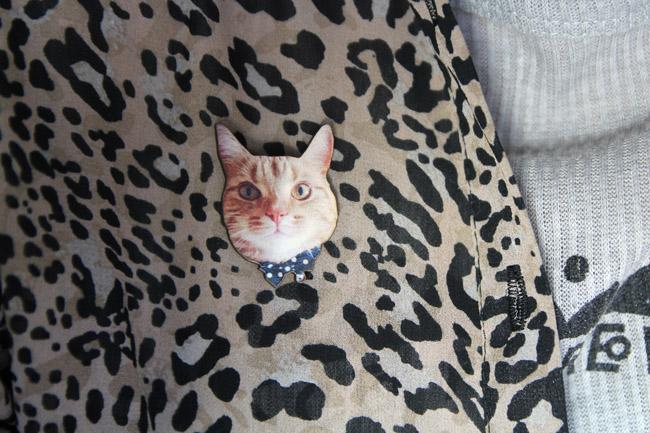 cat badge on shirt