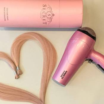 human hair extensions styled with heated styling tools