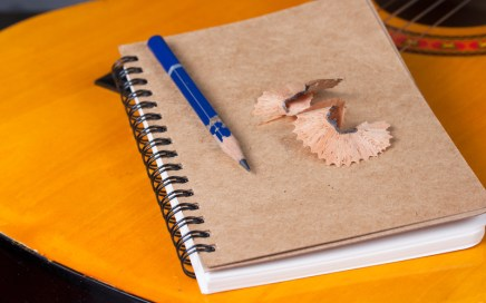 Guitar, paper and pencil