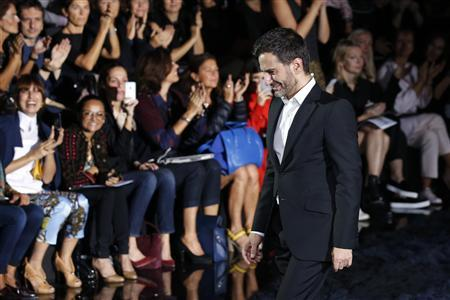 Marc Jacobs appears at the end of his Spring/Summer 2014 women's ready-to-wear fashion show for French fashion house Louis Vuitton during Paris fashion week