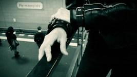 someone in a black leather jacket at the Hermannplatz subway station platform