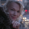 A still image from the film, One Last Time, showing a beautiful older woman with a slight smile.