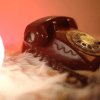 A still image from the short film, The Receiver of a manual dial telephone.